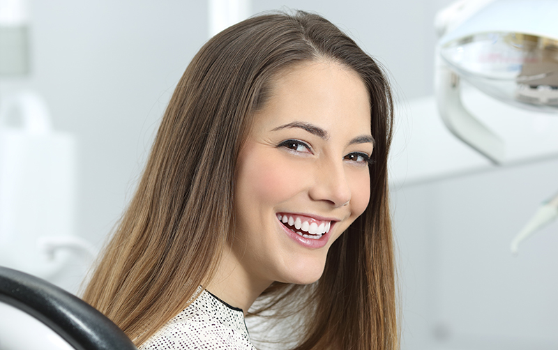 dentist patient showing her perfect smile